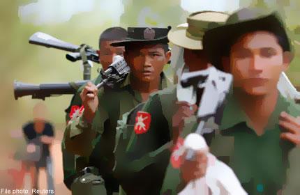 Photo of Burma Army officer beats up Karen villagers