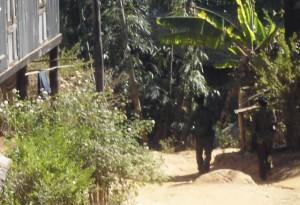 Burma army patrolling in Karen village