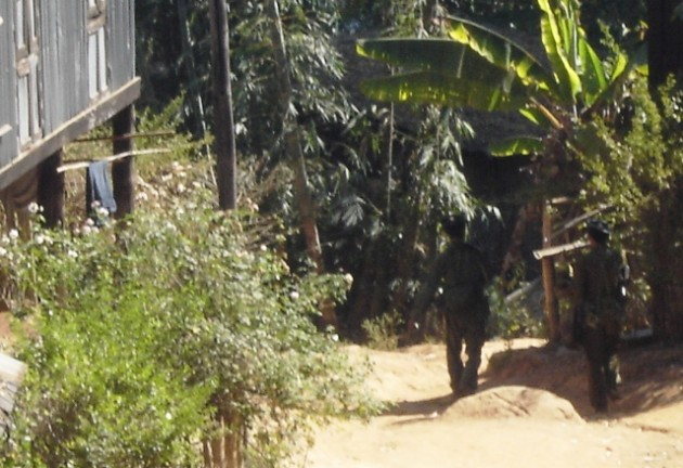 Burma army patrolling in Karen village