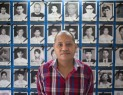 Saw Thet Thun, from AAPP, stands in front of photos of political prisoners allegedly killed by Government authorities (Photo: Karen News)