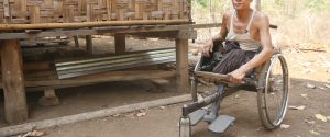 Kyar Khin, a farmer in Aung Chan Thar village in Kyaukkyi township in eastern Myanmar's Kayin State, lost both his legs following a land mine injury. (Photo: David Doyle/Myanmar Now)