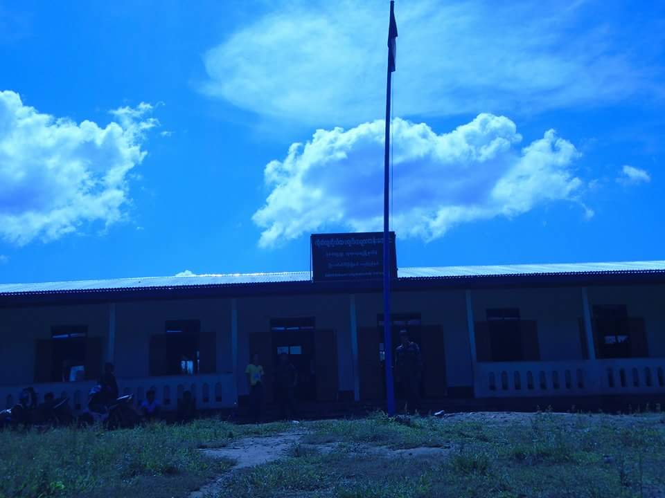 Photo of Burma Army Soldiers Remove Karen National Flag From School