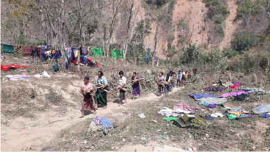 Photo of Chin Villagers Fleeing from the Burma Army Jet Attacks